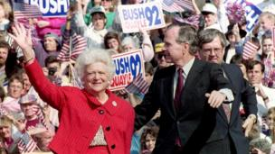 US President George Bush and First Lady Barbara Bush wave to supporters 12 October, 1992 at a campaign rally in Springfield, Pennsylvania.
