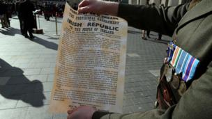 An Irish soldier holds a copy of the proclamation of Irish independence, which was first read at the start of the Easter Rising in 1916