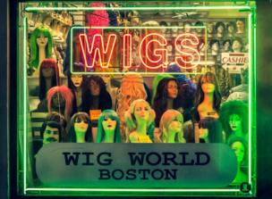 A window display of wigs
