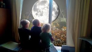 Moon balloon superimposed outside a window