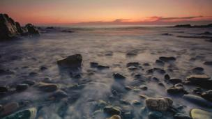 Porth Swtan on Anglesey during sunset - lots of mist among the rocks