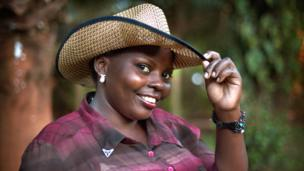 Maria Nakiweewa, 23, wears a cowboy hat in Kampala, Uganda