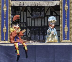 Two Punch and Judy dolls put on a show