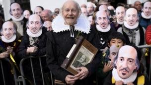 People in Shakespeare masks in Stratford-upon-Avon