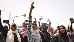 Sudanese demonstrators gather in a street in central Khartoum on April 11, 2019, after one of Africa's longest-serving presidents was toppled by the army
