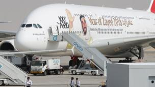 An Airbus A380 of Emirates bearing the portrait of late UAE's founder and late president Sheikh Zayed bin Sultan al-Nahayan during the Dubai Airshow on November 12, 2017