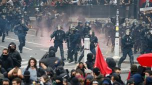 French riot police try to disperse demonstrators