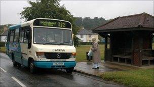 Elderly woman getting on bus