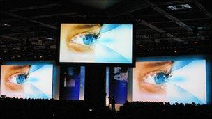 picture of three eyes on three screens