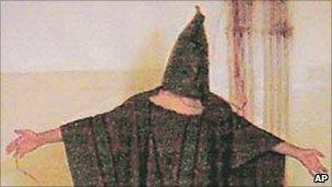 Iraqi prisoner being abused at Abu Ghraib