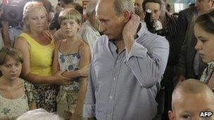 Russian Prime Minister Vladimir Putin meets people displaced by fires in Voronezh, 4 August