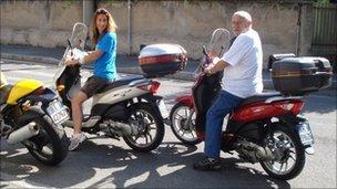 Maria Ferrario and her father Luigi sitting on their mopeds