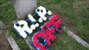 Gravestone and flowers