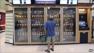 A shopper examines one of the wine vending machines at a Pennsylvania supermarket - 25 June 2010