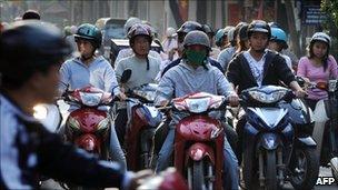 File image of motorcycle riders in Hanoi, Vietnam