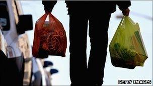 Man carries shopping bags