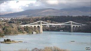The Menai bridge across the strait between Anglesey and the north Wales mainland