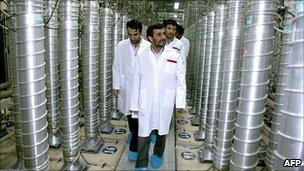 Iranian President Mahmoud Ahmadinejad walks past centrifuges at the Natanz uranium enrichment facilities (2008)