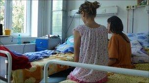 Nicoleta and Amalia sitting on hospital bed