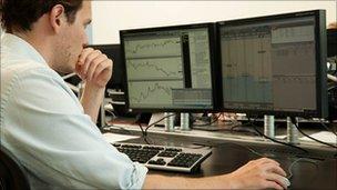 Edwin Lane at trading screens