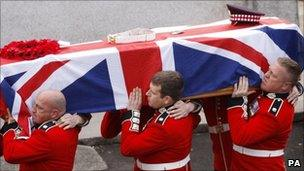 Stephen Monkhouse' coffin being carried