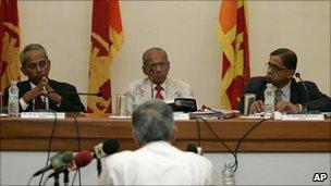 Former Sri Lankan diplomat Bernard Gunathilaka, back to camera, testifies on the first day of public hearings in the commission looking into Sri Lanka's civil war in Colombo, Sri Lanka, 11 August 2010