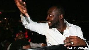 Wyclef Jean waves to supporters before the ruling is announced 20 Aug 2010