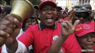 South African state workers seeking higher wages take part in a protest march in Johannesburg on 26 August 2010