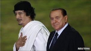 Libyan leader Col Muammar Gaddafi (left) in Rome with Italian PM Silvio Berlusconi, 30 Aug 10