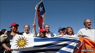 Andes plane crash survivors Ramon Sabella, Gustavo Zerbino and Pedro Algorta pose with relatives of the trapped Chilean miners