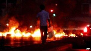 Burning tires in Jidhafs, Bahrain, on the outskirts of the capital of Manama - 16 August 2010