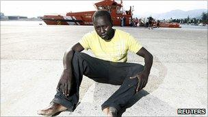 A would-be immigrant rests after arriving at the port of Motril, southern Spain. Photo: August 2010