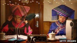 Minority language translators at work at the National People's Congress
