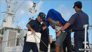 Japanese Coast Guard take Chinese captain Zhan Qixiong into custody (8 September)