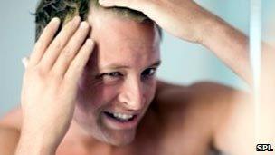 Man checking for balding