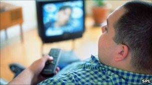 Watching TV. Gustoimages/SPL