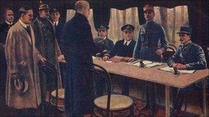 Colourised photograph shows the German delegation, at left, as they arrive to sign the Armistice provisionally ending World War One, in a train dining car in Rethonde, outside Compiegne, France, November 11, 1918