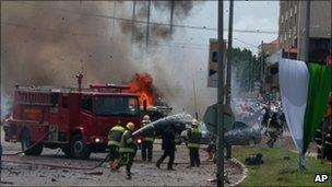Fire-fighters after the Abuja blasts