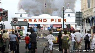 Onlookers watch as Weston-Super-Mare's Grand Pier burns in 2008