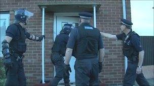 Police officers raid house