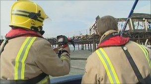 Firefighters take pictures of Hastings Pier