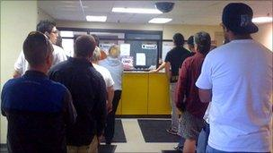 A line of people waiting to take the 24/7 Sobriety Program test
