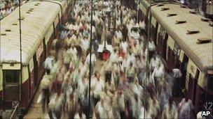 Commuters at a railway station in Bombay (Image: AP)