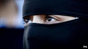 A Muslim woman wearing a niqab
