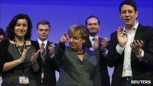 Angela Merkel (centre) among delegates at the congress of the youth wing of the CDU in Potsdam