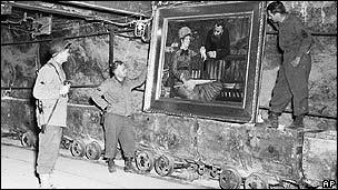 US soldiers with a Manet painting found in a German vault in April 1945
