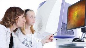 Woman looking at retinal image
