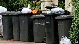 Wheelie bins full of rubbish