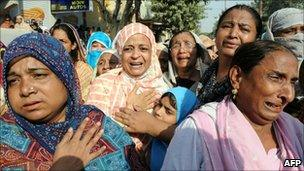 A funeral for victims of the market attack in Karachi on 20 October 2010