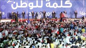 Bahrainis attend a rally for the Shia al-Wifaq society in Manama (20 October 2010)